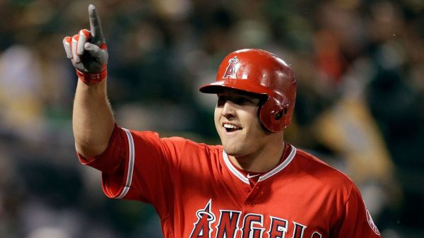The Angels' Mike Trout celebrates after hitting a two-run home run against Oakland on Monday. (Ben Margot / AP)